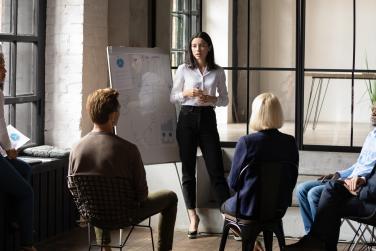 Woman speaking to her work team members