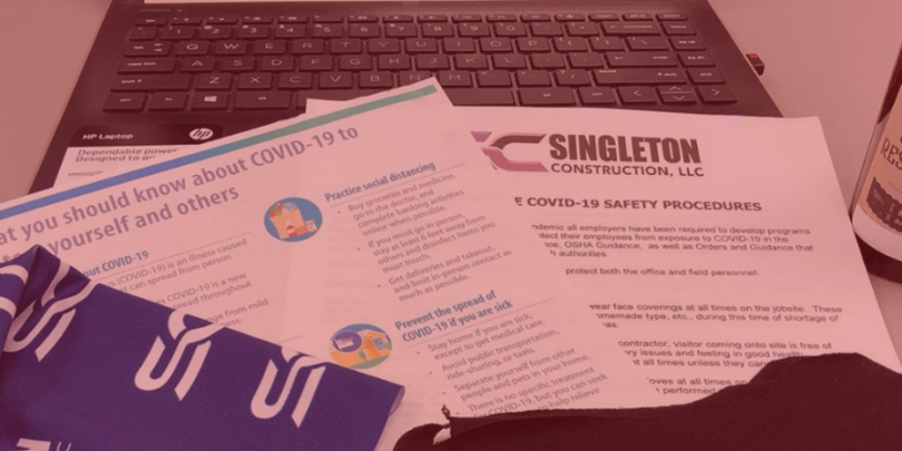 Laptop & papers with Singleton logo and Covid-19 guidelines