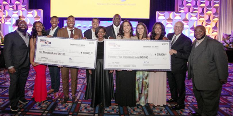 Fisher's NBMBAA case competition teams with their checks
