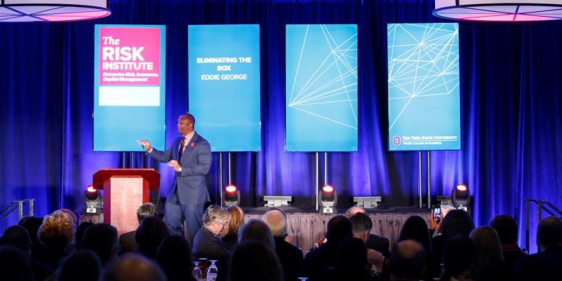 Eddie George speaking at annual conference