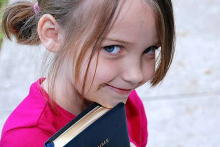 young-girl-holding-a-bible-horiz
