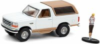 Ford Bronco Eddie Bauer 1996 with Backpacker in 1:64 scale by Greenlight