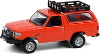 1995 Ford Bronco Sport with Off-Road Parts in Orange in 1:64 scale by Greenlight
