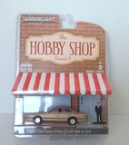 1992 Ford Crown Victoria gold in 1:64 scale from Greenlight