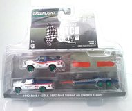 1992 Ford F-150 and 1992 Ford Bronco BFGoodrich Rough Riders on Flatbed Trailer Solid Pack by Greenlight GREEN WHEELS  in 1:64 scale