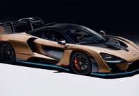 McLaren Senna 2019 metallic gold w/ Display case in 1:18 scale by BBR