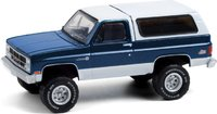 1987 GMC Jimmy Sierra Classic Lifted in Dark Blue and White in 1:64 scale by Greenlight