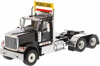 International HX520 Day Cab Tandem Tractor Trailer Black in 1:50 scale by Diecast Masters