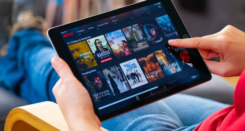 An entrepreneur browsing streaming services on iPad