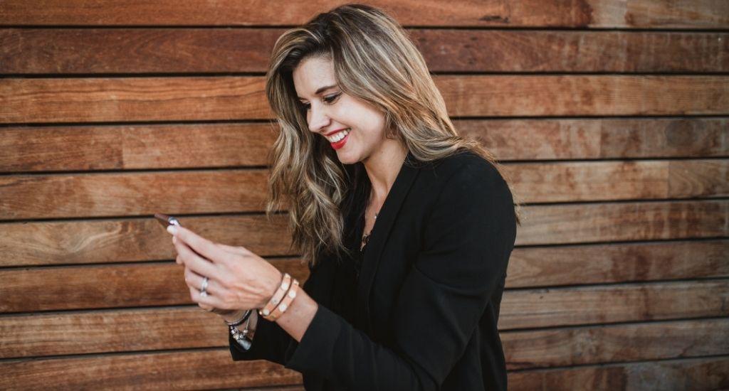 Entrepreneur planning marketing strategy on phone