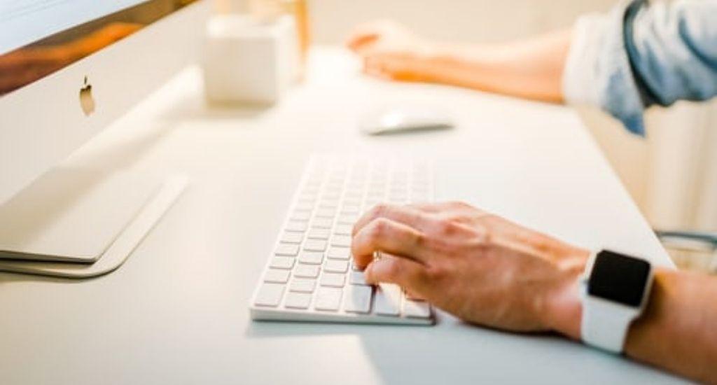 Entrepreneur typing keyword domains on computer