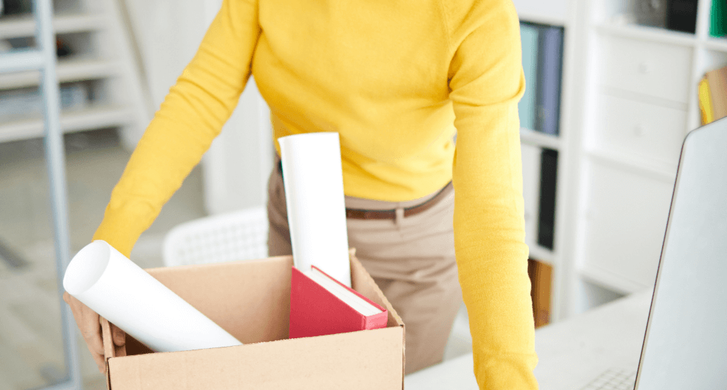 Woman packing after leaving job