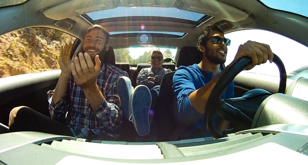 College cofounders riding in car