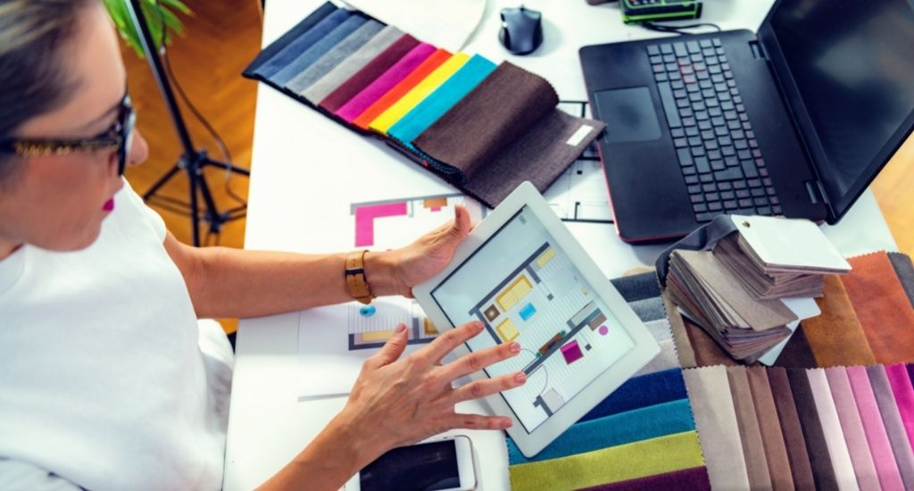 Interior designer studying trending color patterns on tablet