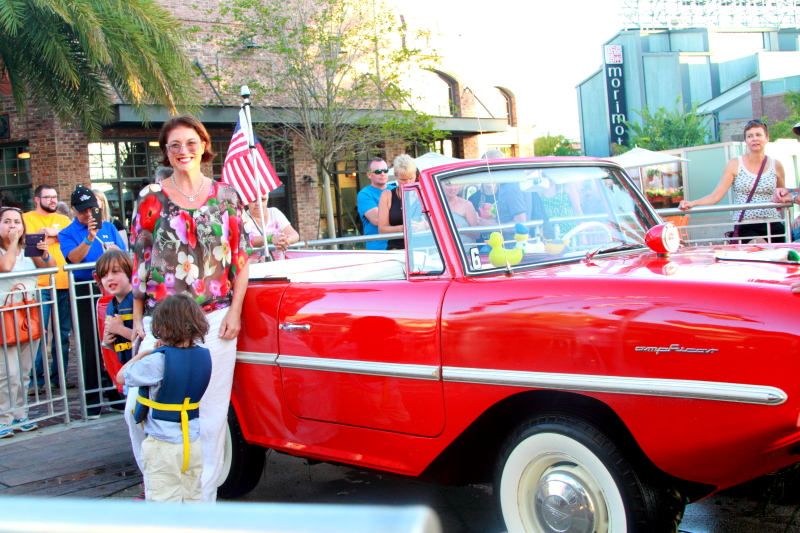 woman and her kids standing in front of an amphicar