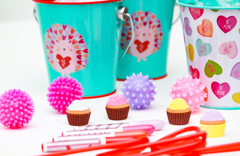 Valentine's Day buckets with mini lip gloss cupcakes and squishy balls