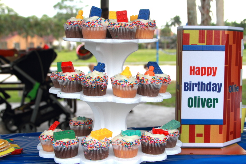 cupcakes on display with a sign that says Happy Birthday Oliver
