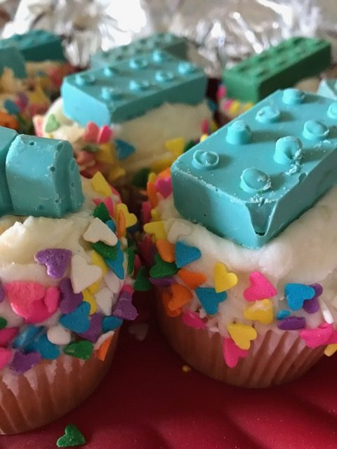 cupcakes with heart sprinkles and chocolate legos on top