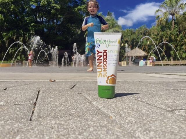 kid running toward sunscreen
