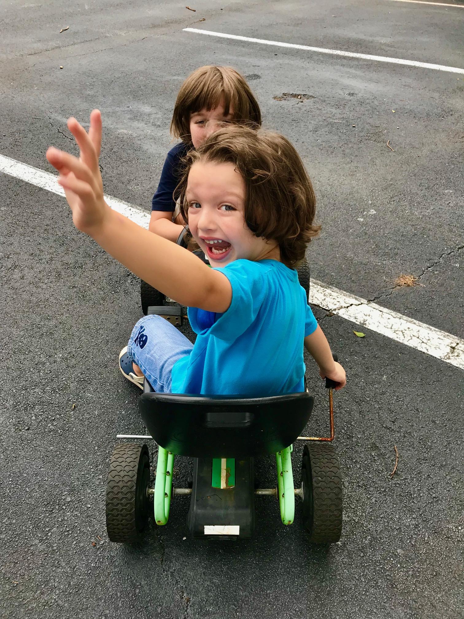 two boys on a go cart