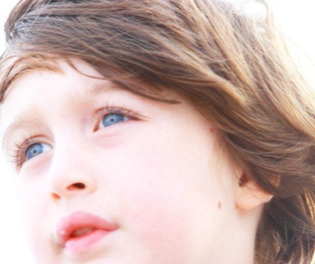 head shot of a boy with blue eyes