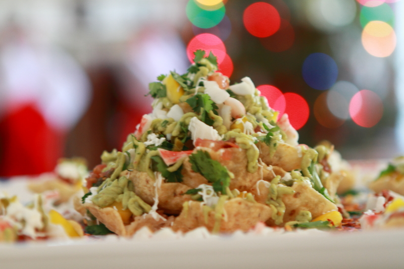 holiday cheeseless and crab nachos in front of lights