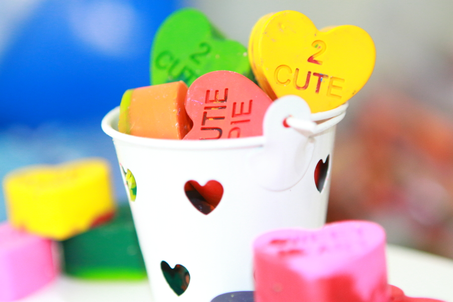 white bucket filled with crayon conversation starters