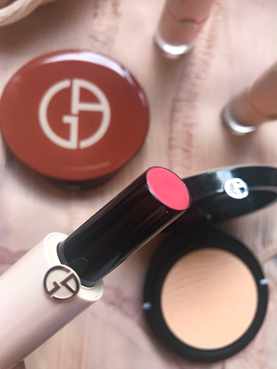 Girogio Armani Beauty Ecstasy Balm Lipstick with makeup in the background
