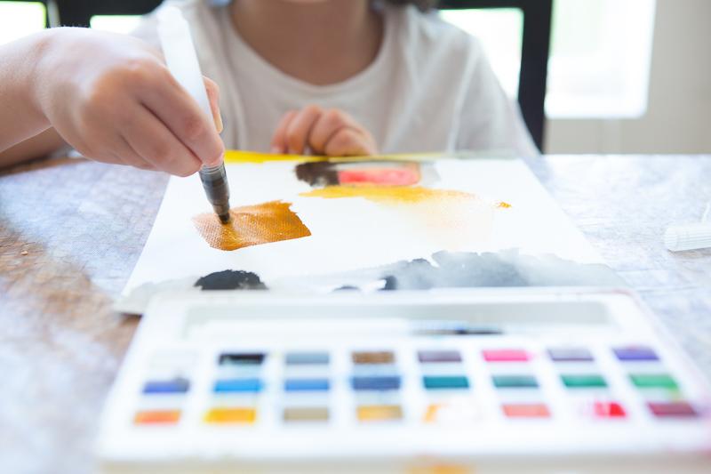 boy paintng watercolors