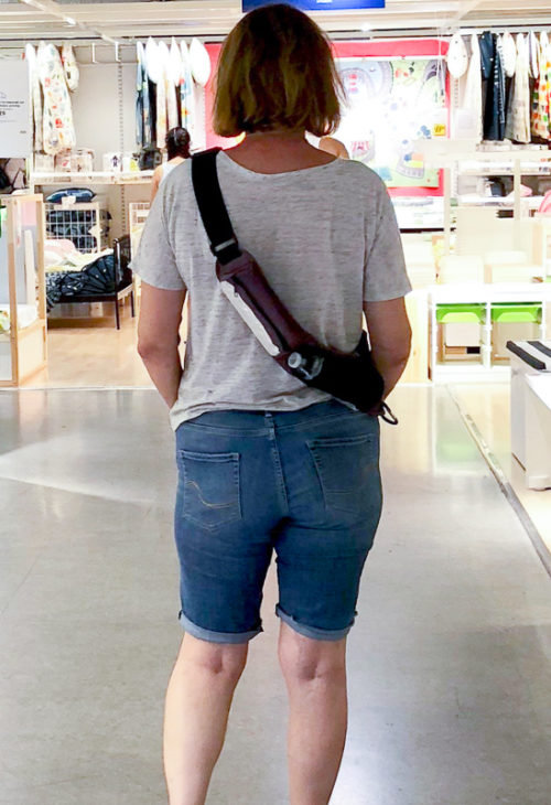 woman standing with a fanny pak