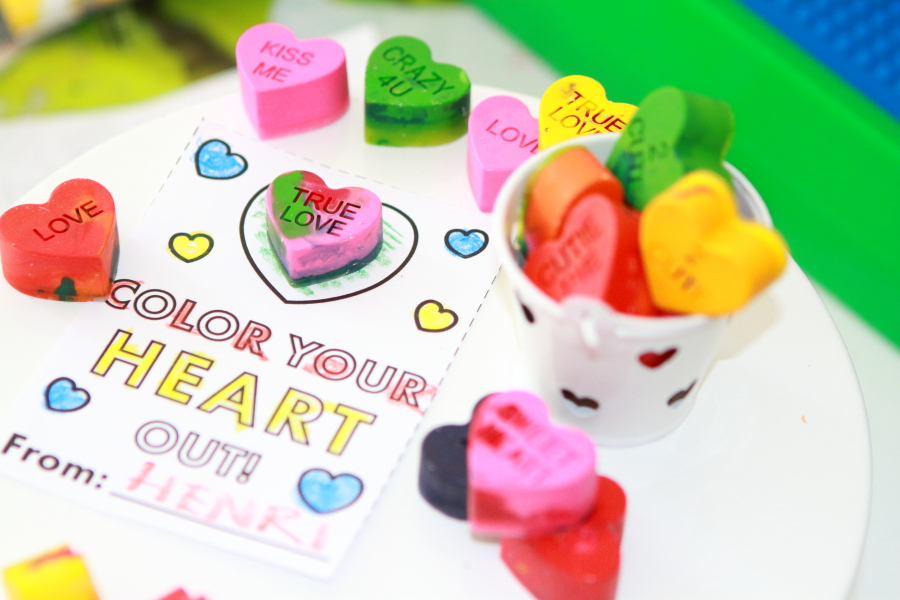 a paper valentine with heart shaped conversation starter recycled crayons