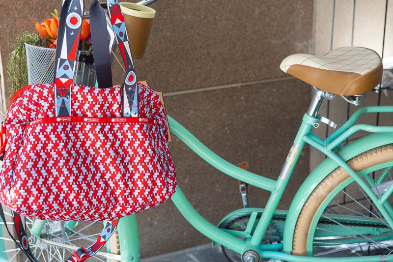 red bag hanging on a vintage green bike