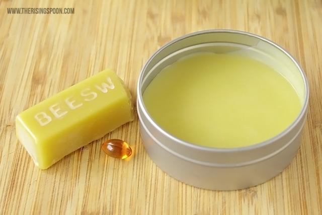 beard balm block and jar of beard balm with a vitamin next to it