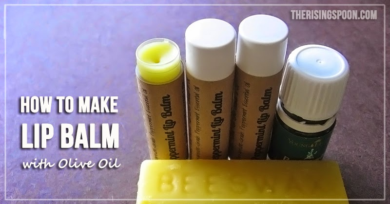4 lips balms with a block of beeswax in front of them