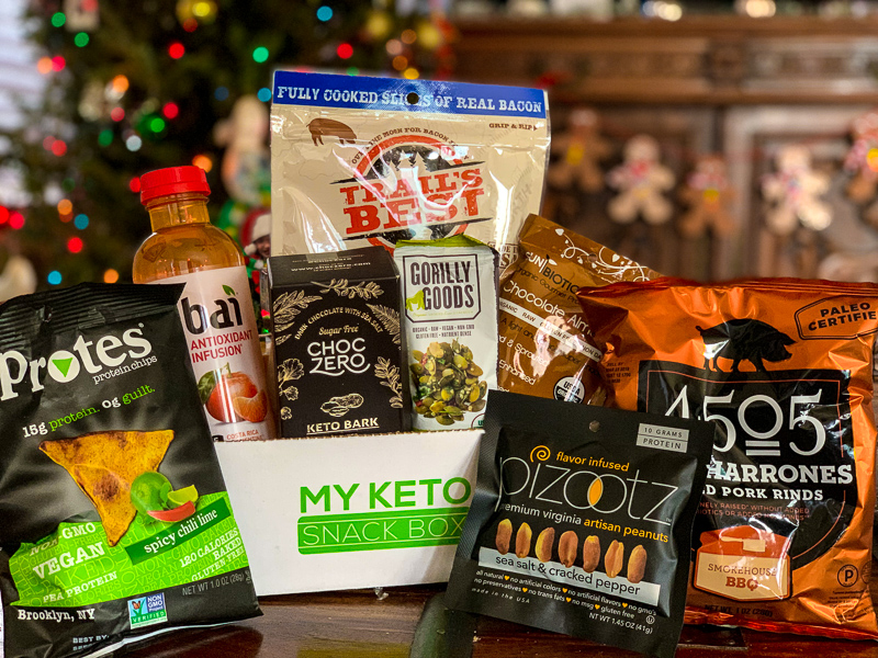 box of keto snacks in front of a christmas tree