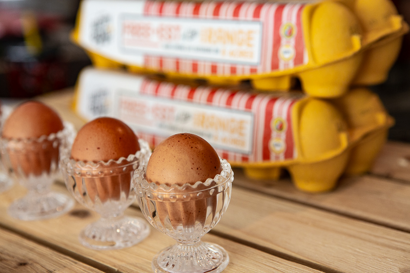 three eggs in clear glass egg cups