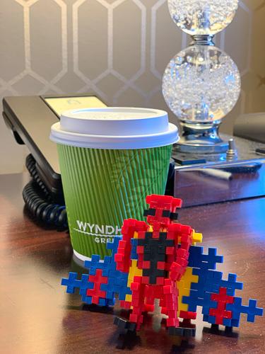 coffee next to plus plus super hero