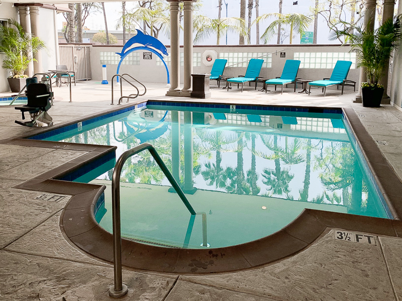 Pool and sunchairs at the Peacock Suites Anaheim California