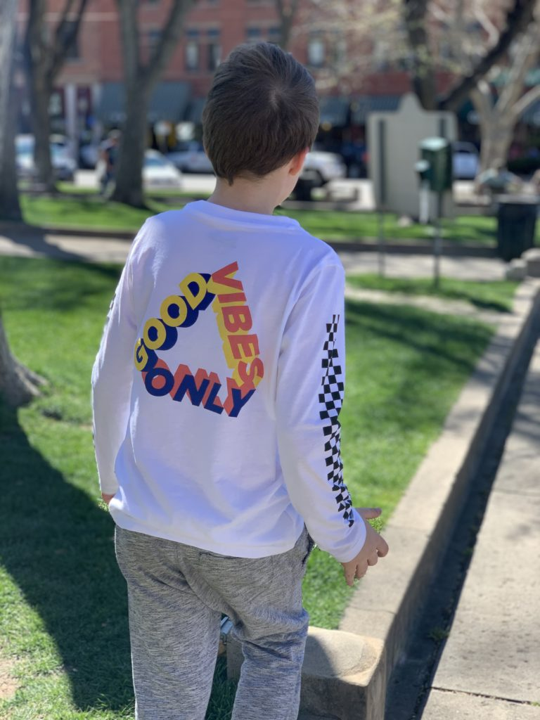 boy wearing good vibes only shirt
