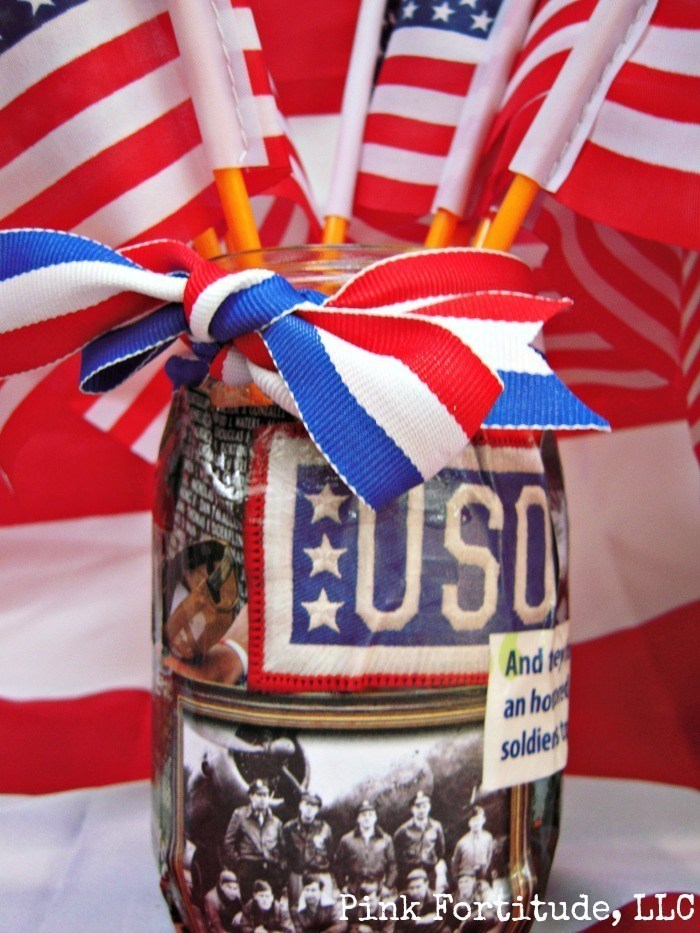 patriotic mason jar with amercian flags and ribbon around it