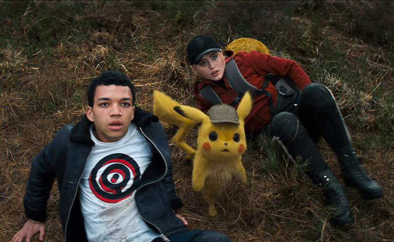 "Justice Smith (left), Detective Pikachu (voiced by Ryan Reynolds) and Kathryn Newton in ""Pokémon Detective Pikachu. Photo Credit: Courtesy of Warner Bros. Pictures"