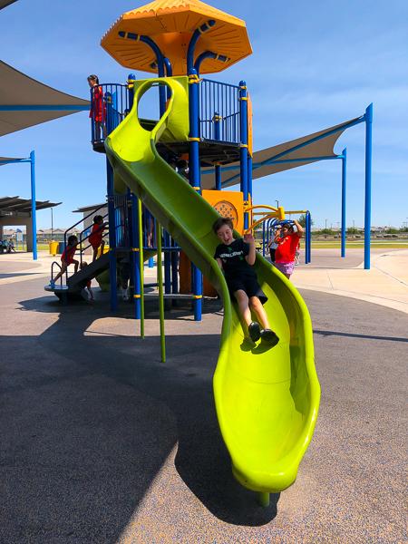 boy going down a slide