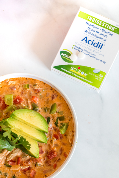 bowl of enchilada soup with Acidil next to it