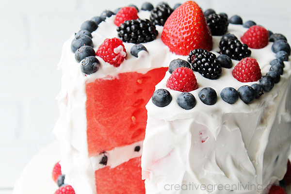 watermelon cake with coconut cream frosting and berries