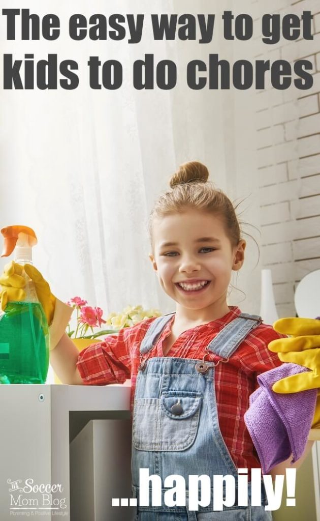 girl holding cleaning supplies smiling