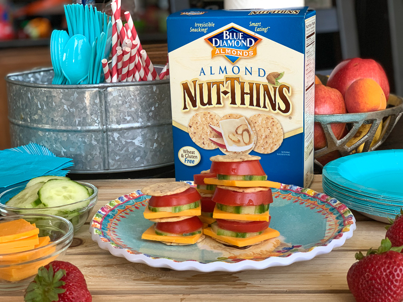 Nut Thins Almond with little tomato, cucumber and cheese cracker sandwhiches.