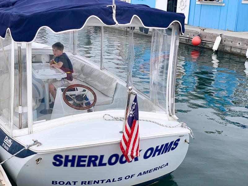 boat rental that says Sherlock Ohms