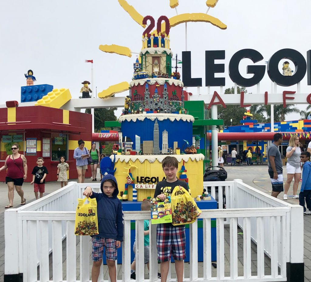 two boys showing their purchases at Legoland California