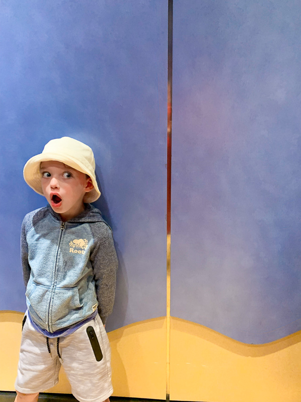 boy inside an elevator with a suprised face