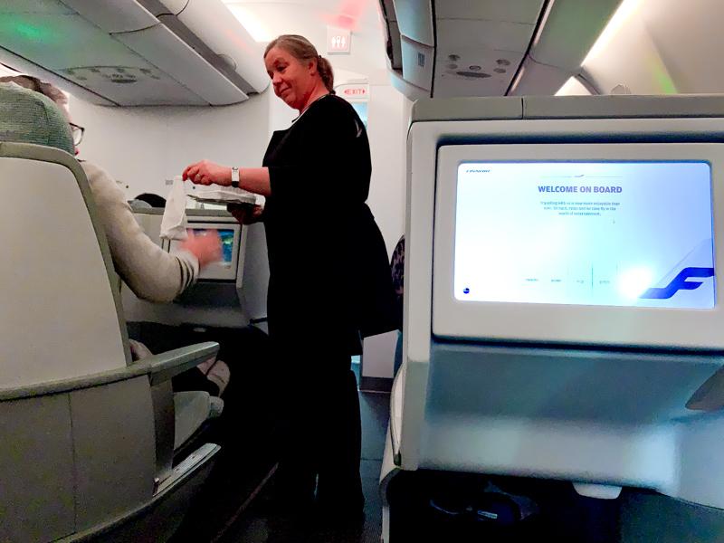 stewardess serving customer on a plane